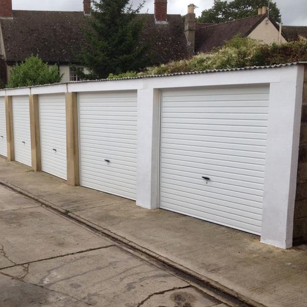 novoferm steel canopy up over garage doors in white. Black Bedroom Furniture Sets. Home Design Ideas