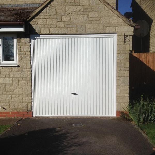 novoferm steel canopy up over garage door in white. Black Bedroom Furniture Sets. Home Design Ideas