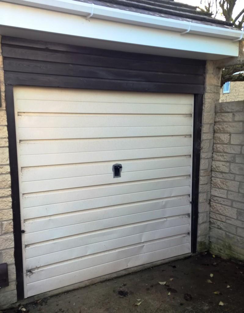 Black thermaglide 77 automated roller garage door in witney elite gd before rubansaba
