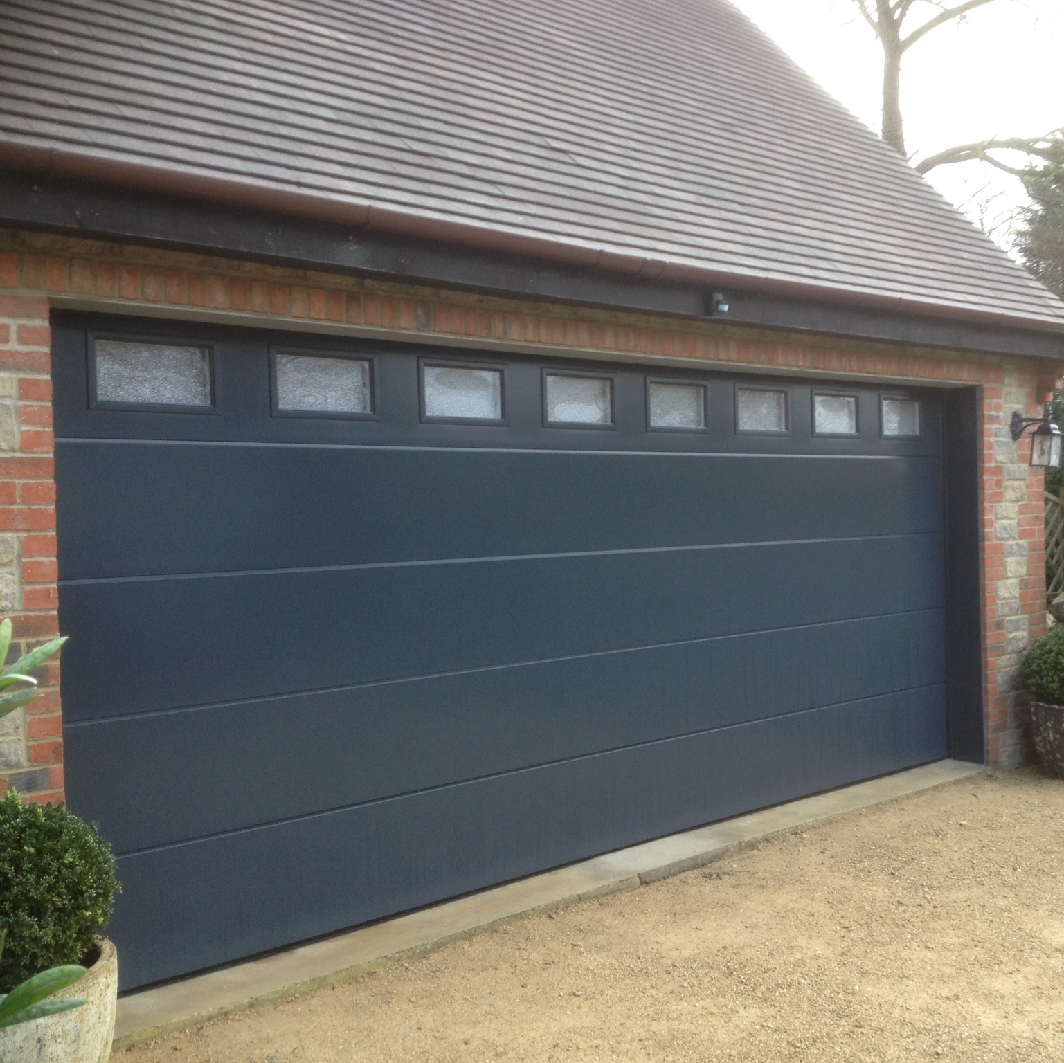 Sectional garage door with windows for Drive through garage door