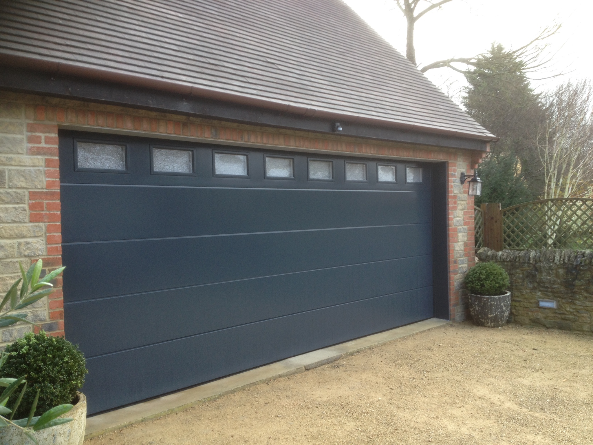 Sectional garage door with windows anthracite grey flush smooth sectional with windows rubansaba