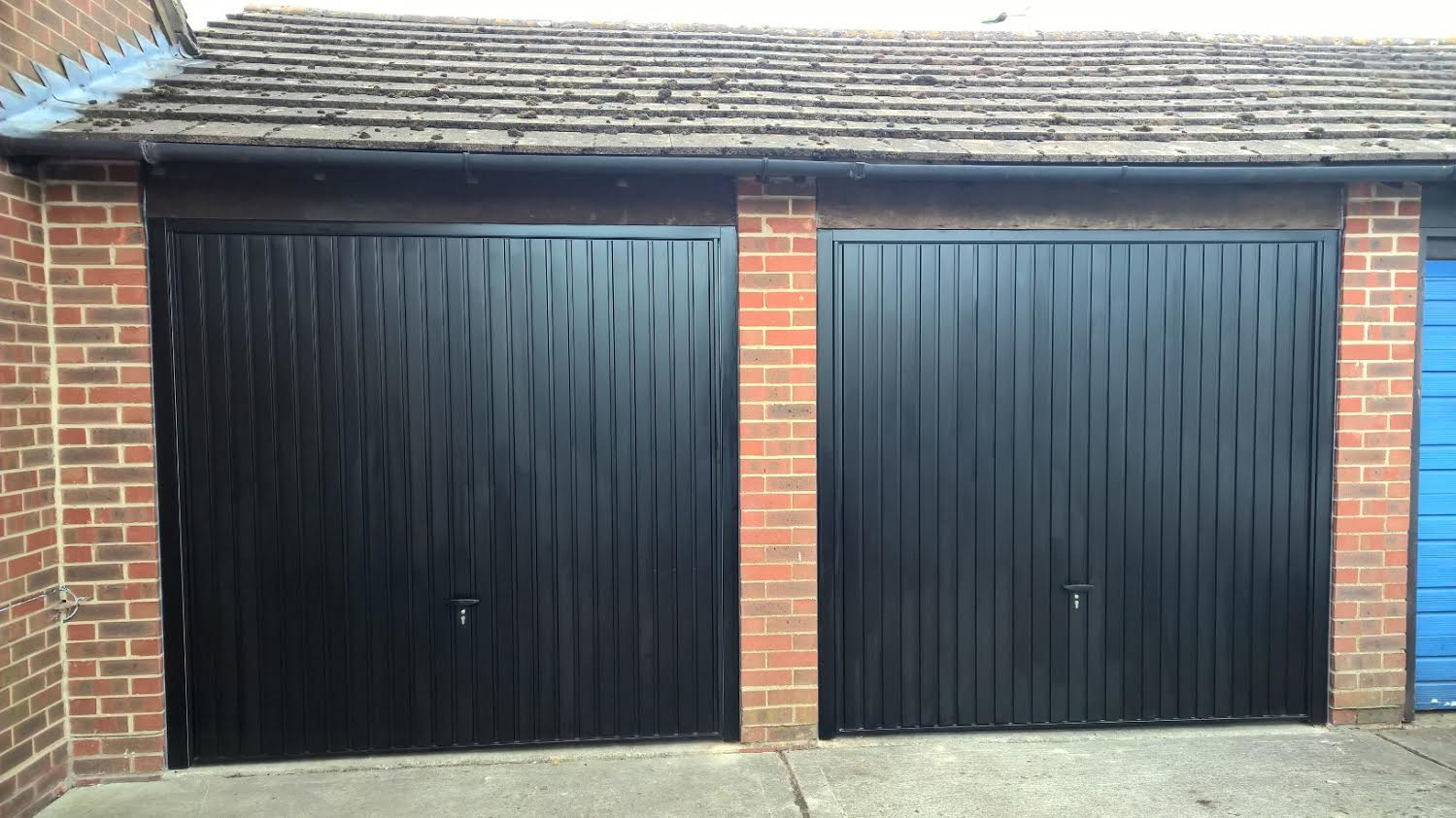 Retractable garage door - Black Thornby Retractable Garage Door Didcot