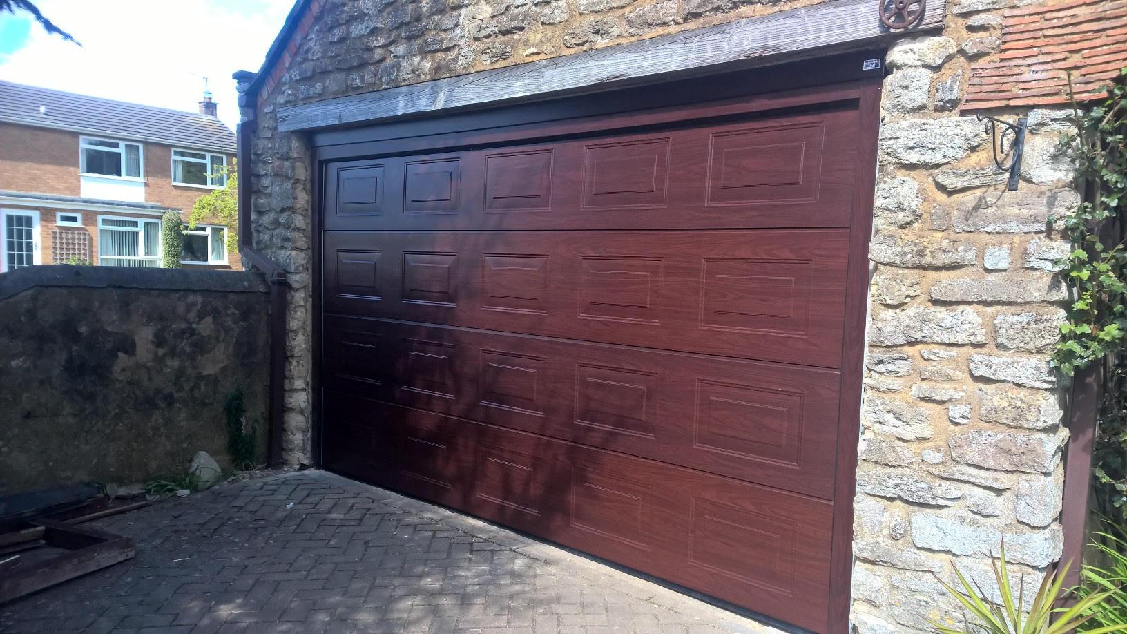 novoferm iso 45 panelled sectional garage door in rosewood. Black Bedroom Furniture Sets. Home Design Ideas