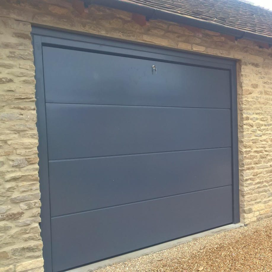 Trio Of Iso 45 Flush Sectional Garage Doors In Ral7015