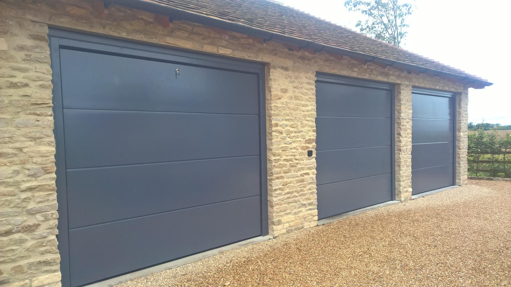 Trio of iso 45 flush sectional garage doors in ral7015 elite gd trio of iso 45 flush sectional garage doors in ral7015 rubansaba