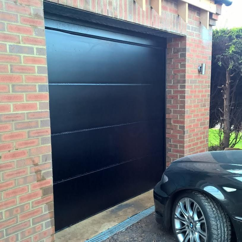 Iso45 Flush Smooth Sectional Garage Doors In Black Elite Gd