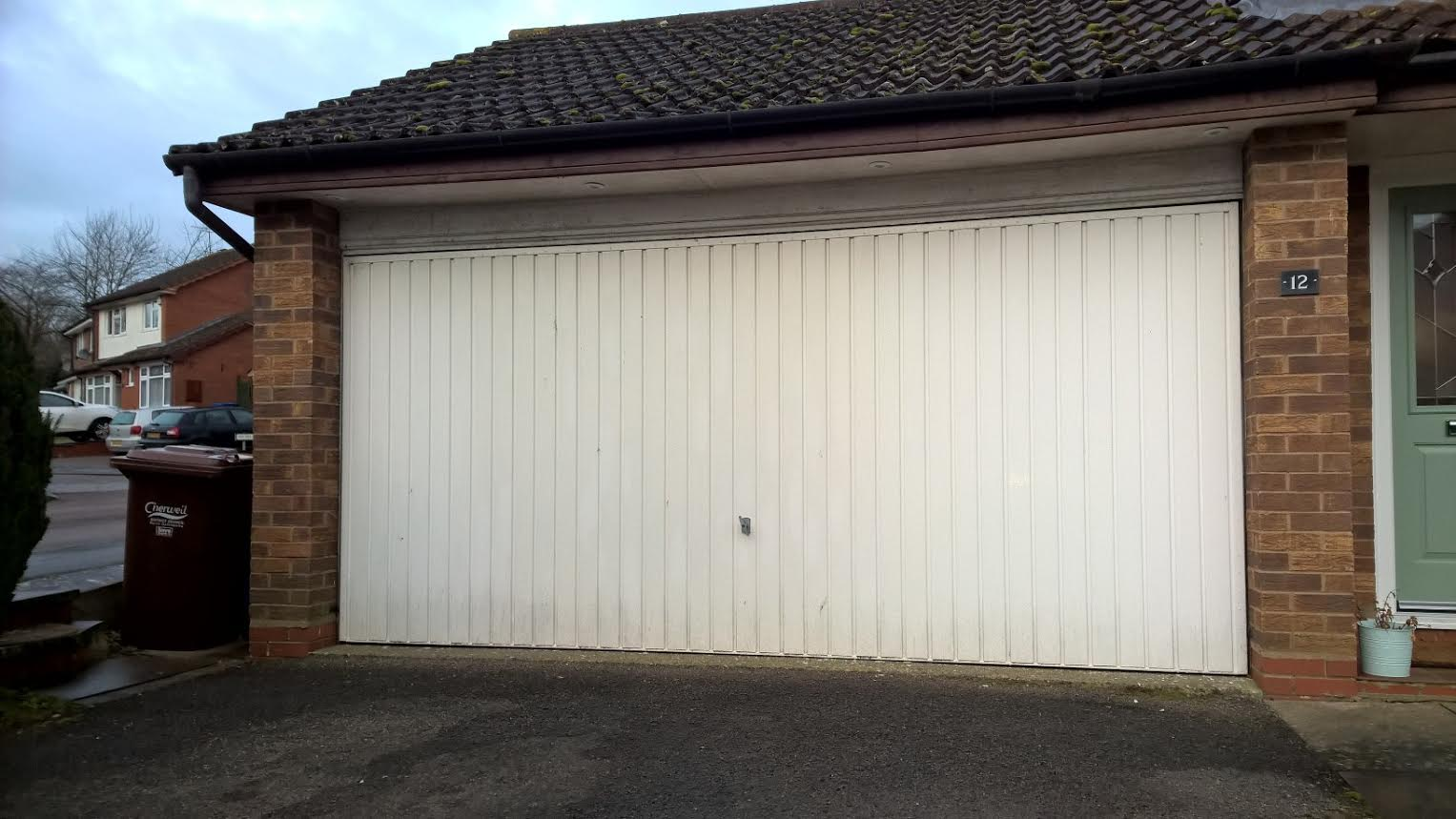 Pair Of 77 Automated Insulated Roller Garage Doors In