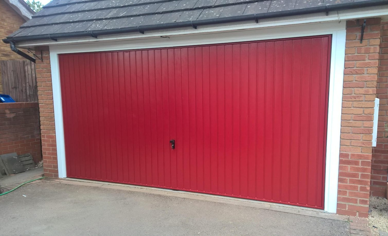 Conversion From Two Single Doors To One Double Garage Door