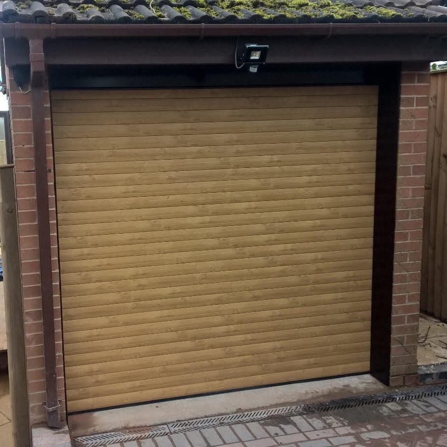 Irish Oak 77 Automated Roller Garage Door Installed In