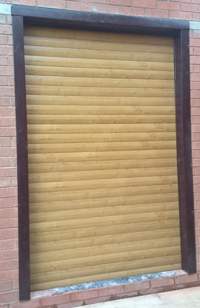 Irish Oak 77 Automated Roller Garage Door Installed In Redditch Elite Gd