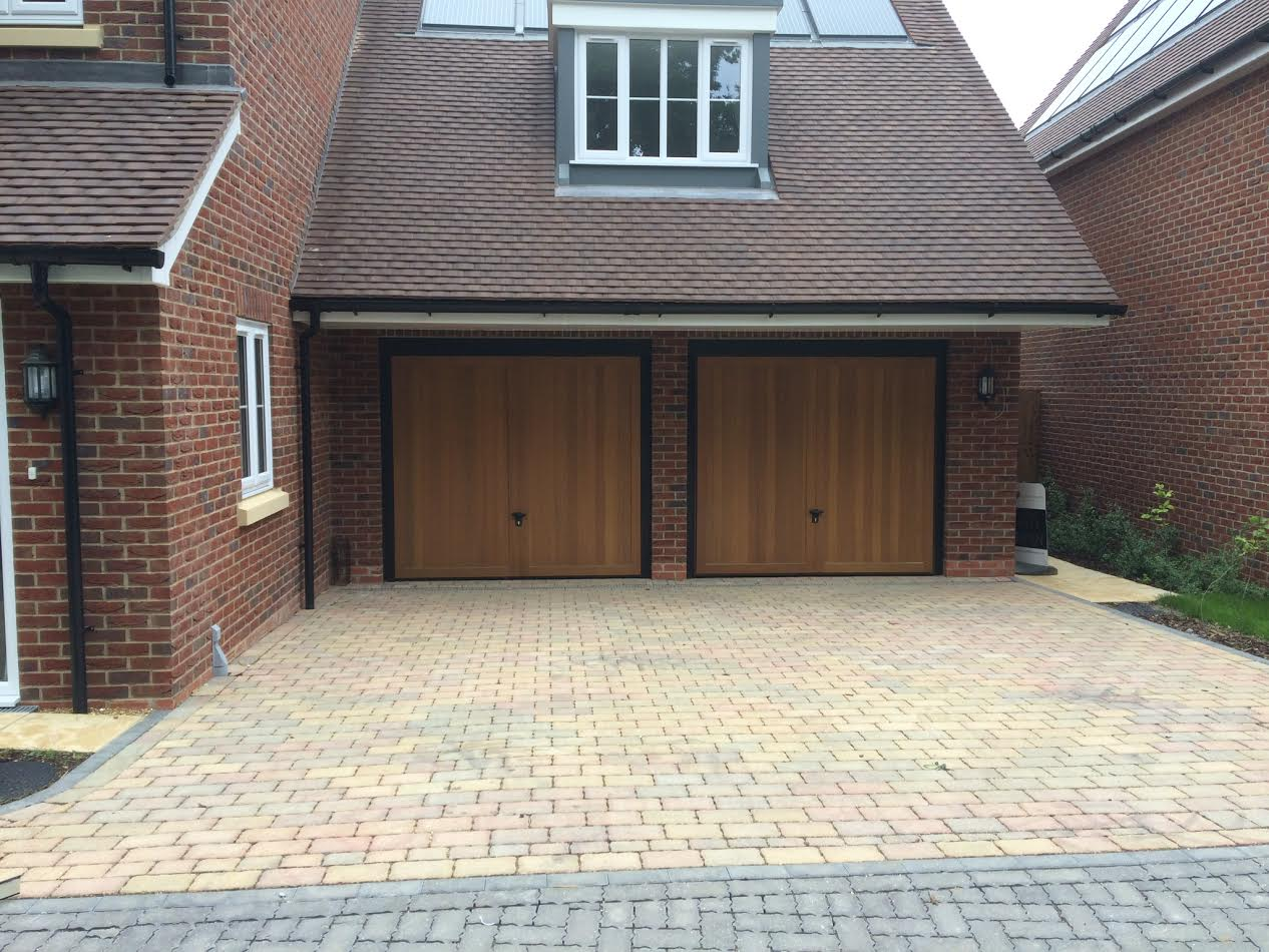 Retractable garage door - Timber Retractable Garage Door For New Build Site