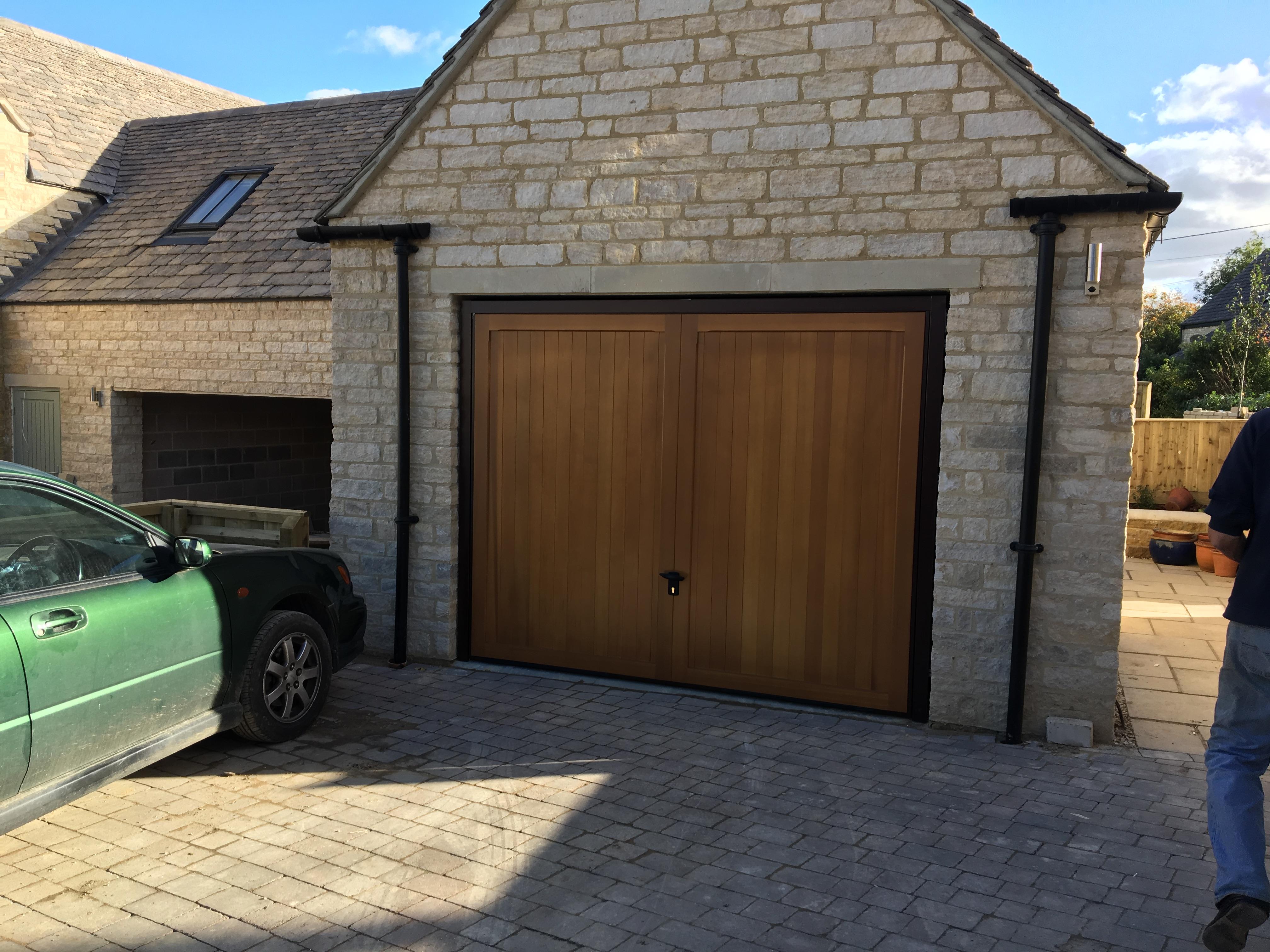 Garage door archives elite gd cardale timber retractable garage doors berkeley vertical design fully finished in light oak installed in shipton under wychwood rubansaba
